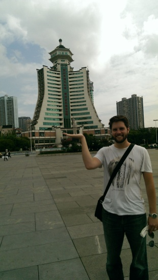 This is Dave, happily holding up a statue of Chairman Mao.