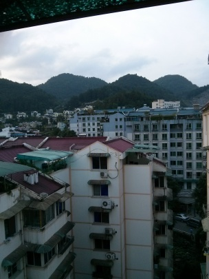 This was the view from our living room window in our last apartment.  Guiyang has basically been carved into the mountains.  Today we scooted through 3 tunnels as we explored the city.  If a mountain is in the way of progress...they carve a hole into it