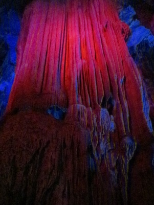 Beautiful formations, lit up with red lights.  These took thousands of years to form.  Nature is so cool :)