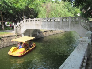 Nice little bridge and a paddle boat.  We never had time to rent one, but  I've always been impressed at how clean they keep this water.  Very unusual for China!