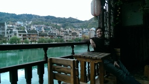 Dave, sitting on our room's balcony, overlooking the river