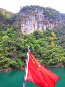 Beautiful Guizhou mountains, and our boat's flag :)