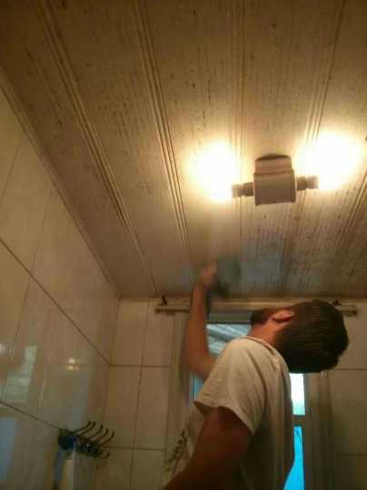 Dave, wiping the mold and grime off of the bathroom ceiling...