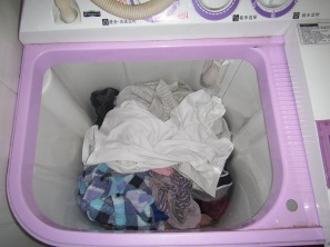Step 5: Round up your clothes and throw them in the washing machine. Make sure that you don't throw in too much because the blue circle will only spin with a key amount of clothing in the washing machine