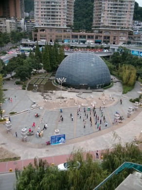 This was the view from the bedroom of our old apartment. The dome is Zhong Tian's pool and the courtyard in front of the dome is where the neighbors excercise in the morning, dance at night and practice gong fu daily