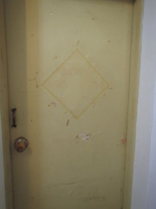Our bedroom door. We took the red poster off, but the tape remains...
