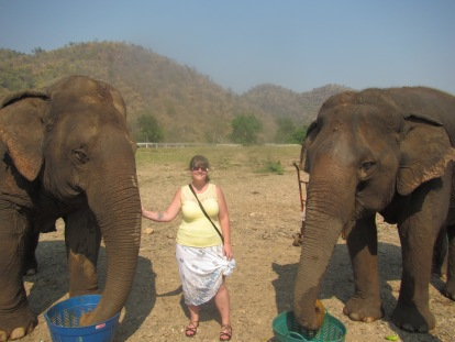 Me and one of my favorite elephants (the one to my right).  The elephant to my left helps take care of Jokia...she's blind.