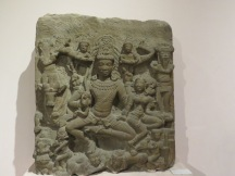 A carving of Shiva and Parvatti, two of the Hindu gods. In it, they are crushing the head of ignorance