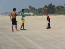 Some kids goofing off on the beach. They came over and asked to taked pictures with us shortly after I got this shot.