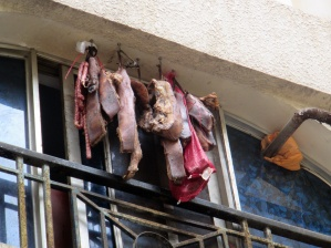 Meat hanging out of an apartment