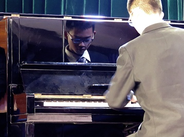 One of the small performances between plays. This is a grade 8 boy from the Elite Department. He plays the piano beautifully and entertained the crowd while I organized the next play to go up