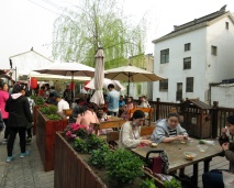 small restaurants are scattered along the canals and you can almost always find a patio like this one
