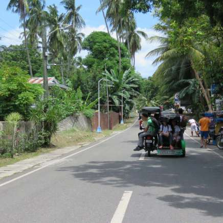 Overloaded trikes are part of the scenery in South East Asia